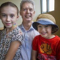 Erik Anderlind, center, and his daughter Cassandra Anderlind and his son Philip. (Jesse Costa/WBUR)