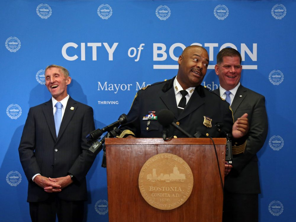 Boston Police Commissioner William Evans, left, announces his departure and Mayor Martin Walsh announces William Gross as the new Boston police commissioner during a press conference at Boston City Hall. (Courtesy of John Wilcox/the mayor's office)