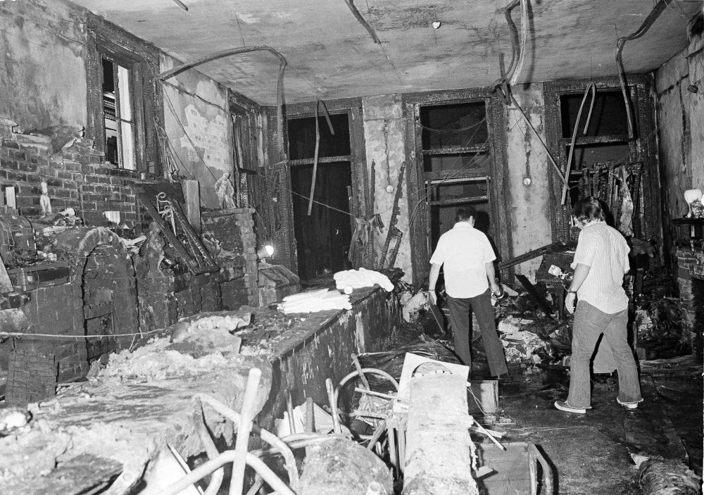 A view inside the UpStairs Lounge following an arson on June 25, 1973. Most of the victims were found near the windows in the background. (Jack Thornell/AP)