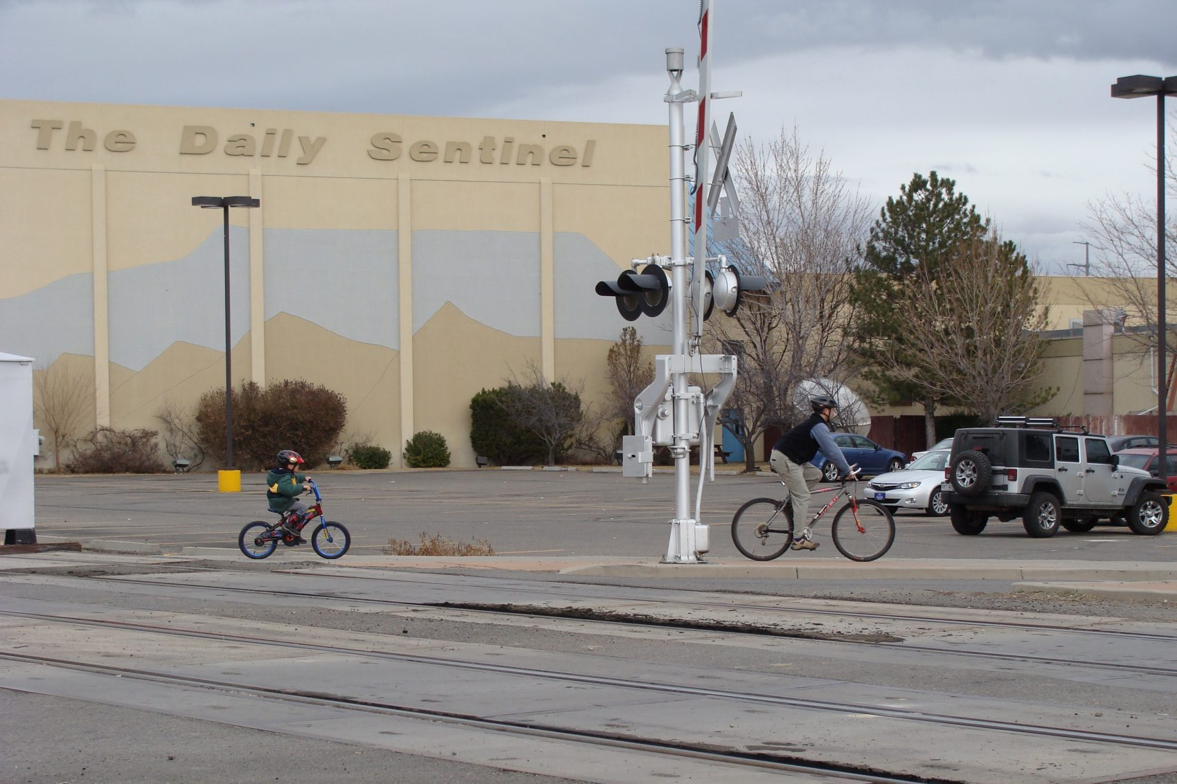 People bike past The Grand Junction Daily Sentinel in Grand Junction, Colo. (jimmy thomas/Flickr)