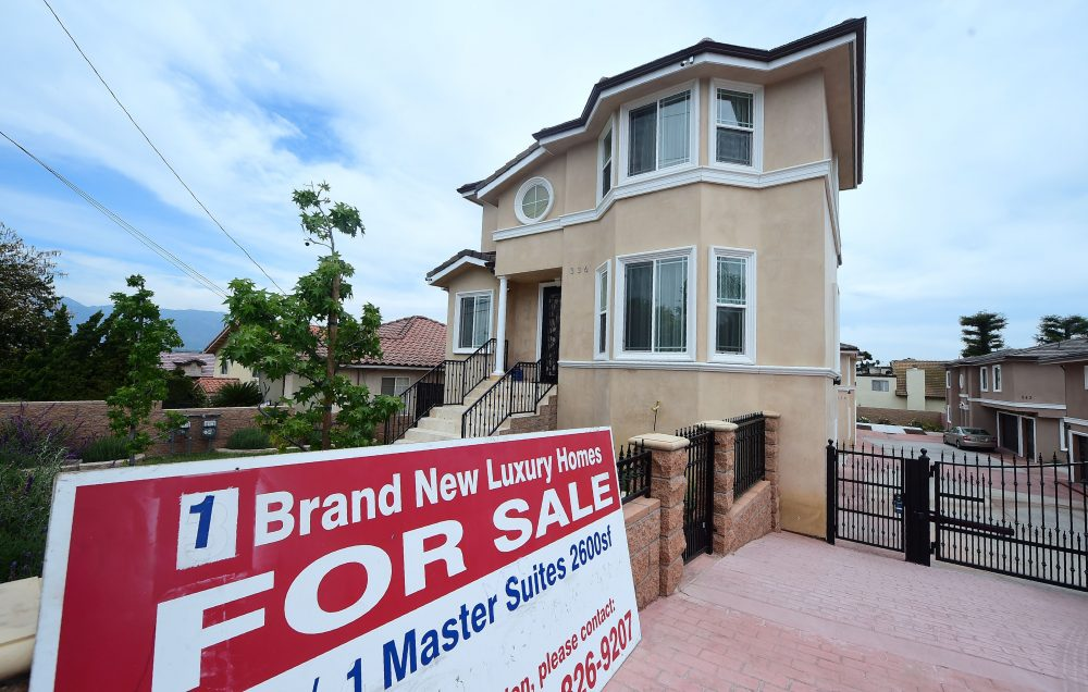 A for-sale sign stands in front of a property in Monterey Park, Calif., in 2017. (Frederic J. Brown/AFP/Getty Images)