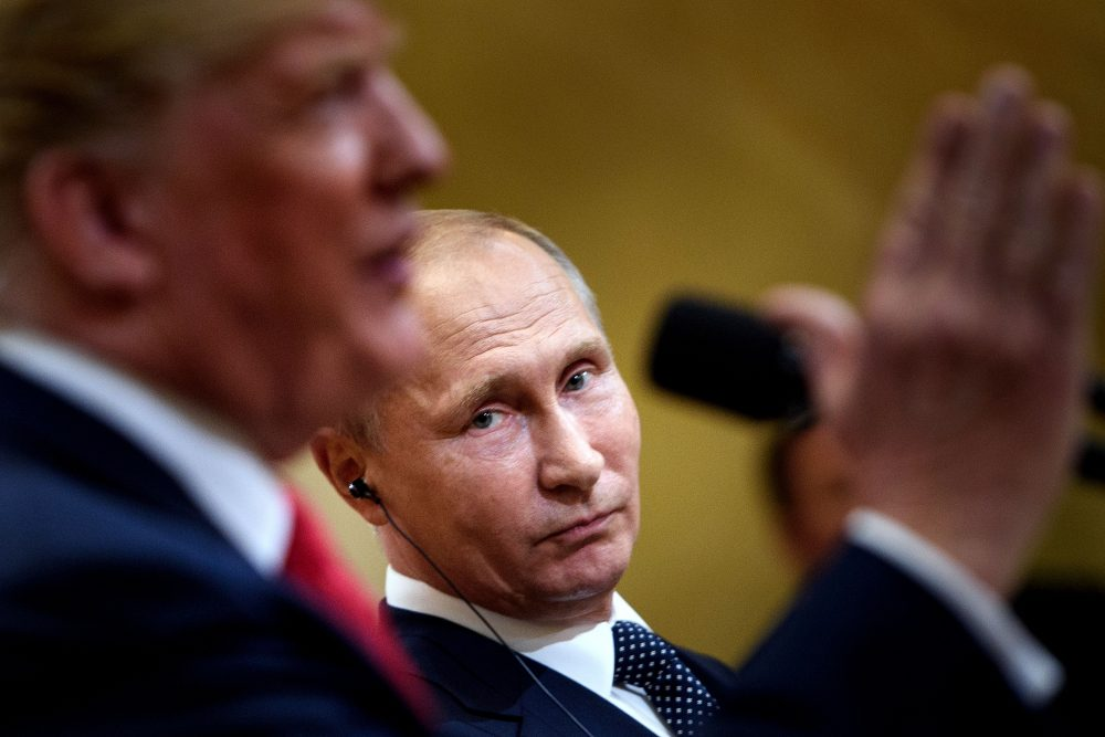 Russian President Vladimir Putin listens while President Trump speaks during a press conference at Finland's Presidential Palace on July 16, 2018 in Helsinki, Finland. (Brendan Smialowski/AFP/Getty Images)