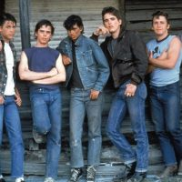 "The cast of ""The Outsiders."" (Courtesy Warner Bros.)"