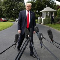 President Donald Trump approaches microphones to speak to the media before boarding the Marine One helicopter on the South Lawn of the White House in Washington, Wednesday, May 23, 2018, en route to a day trip to New York City. (Jacquelyn Martin/AP)
