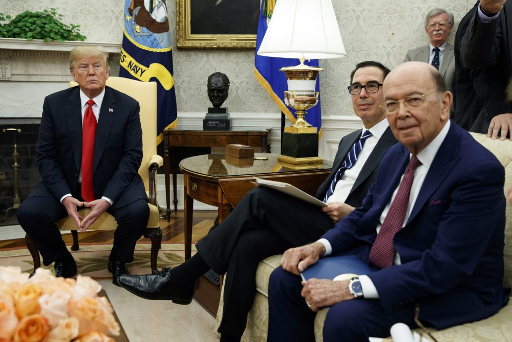 President Donald Trump sits with Secretary of Commerce Wilbur Ross, right, and Treasury Secretary Steve Mnuchin, center, during a meeting with European Commission president Jean-Claude Juncker in the Oval Office of the White House, Wednesday, July 25, 2018, in Washington. National security adviser John Bolton listens at top right. (Evan Vucci/AP)