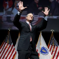 Gov. Charlie Baker acknowledges applause as he takes the stage to address the Massachusetts Republican Convention at the DCU Center in Worcester on April 28, 2018. (Winslow Townson/AP)