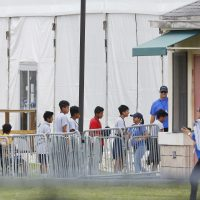 Immigrant children walk in a line outside the Homestead Temporary Shelter for Unaccompanied Children a former Job Corps site that now houses them, on Wednesday, June 20, 2018, in Homestead, Fla. (Brynn Anderson/AP)