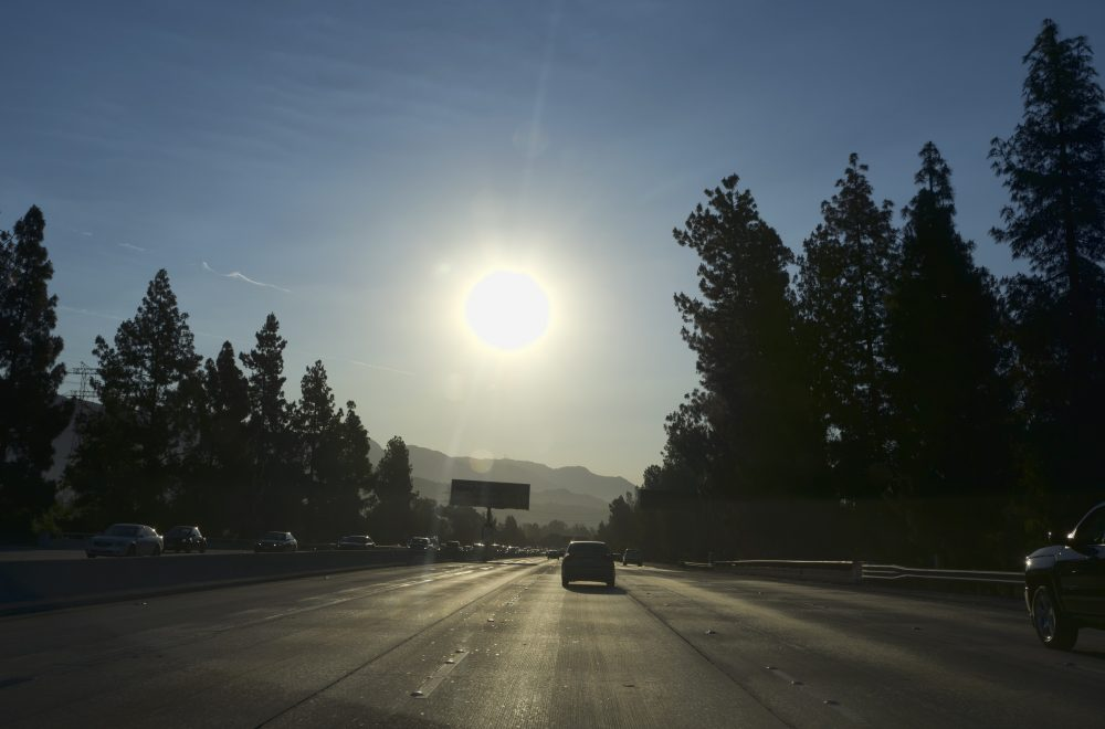 A strong morning sun rises over the Ventura Freeway State Route 134 in Burbank, Calif. on Friday, July 6, 2018. Forecasters say temperatures will soar into triple digits throughout almost all of Southern California as a brief but intense heat wave broils the region. (Richard Vogel/AP)