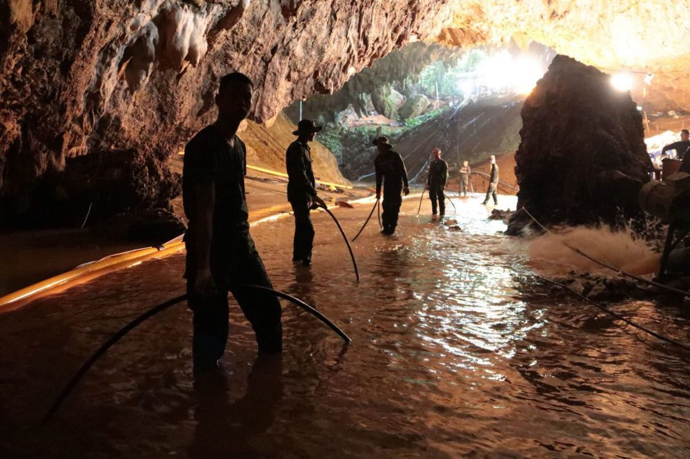 In this undated photo released by Royal Thai Navy on Saturday, July 7, 2018, Thai rescue teams arrange water pumping system at the entrance to a flooded cave complex where 12 boys and their soccer coach have been trapped since June 23, in Mae Sai, Chiang Rai province, northern Thailand. The local governor in charge of the mission to rescue them said Saturday that cooperating weather and falling water levels over the last few days had created appropriate conditions for evacuation, but that they won't last if it rains again.. (Royal Thai Navy via AP)