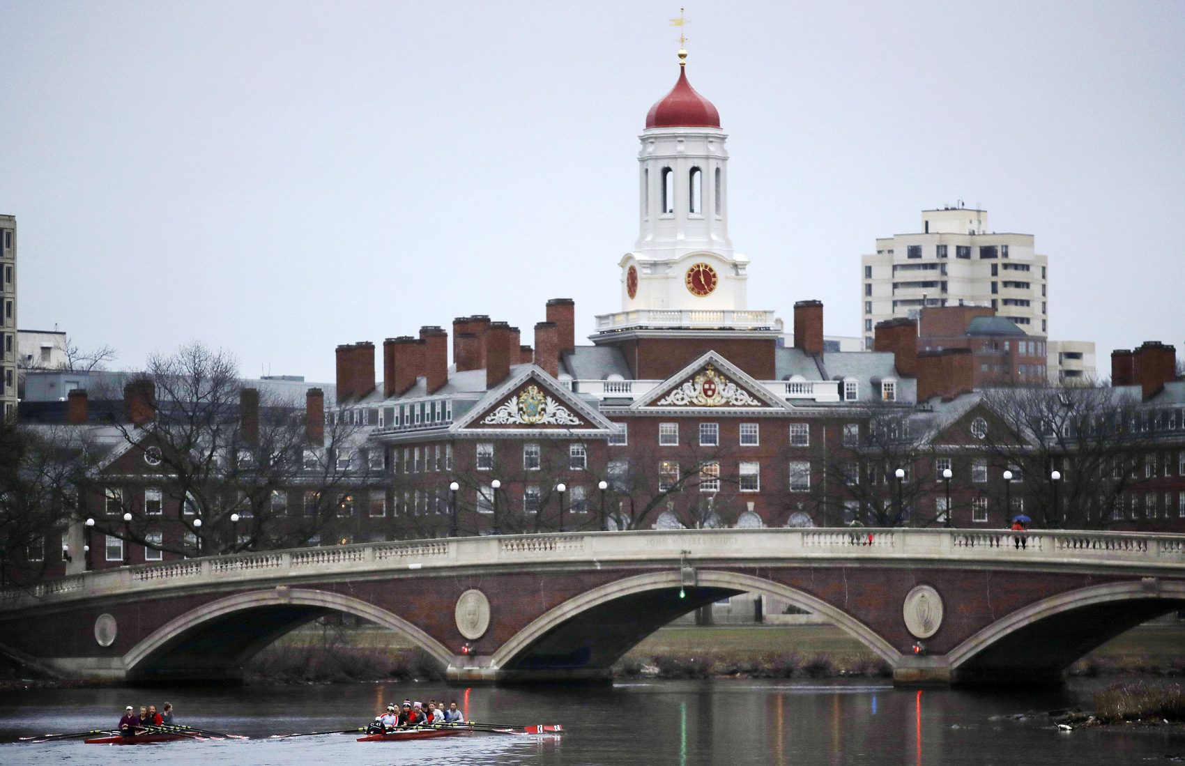 In this 2017 file photo, rowers paddle along the Charles River past the Harvard campus. (Charles Krupa/AP)