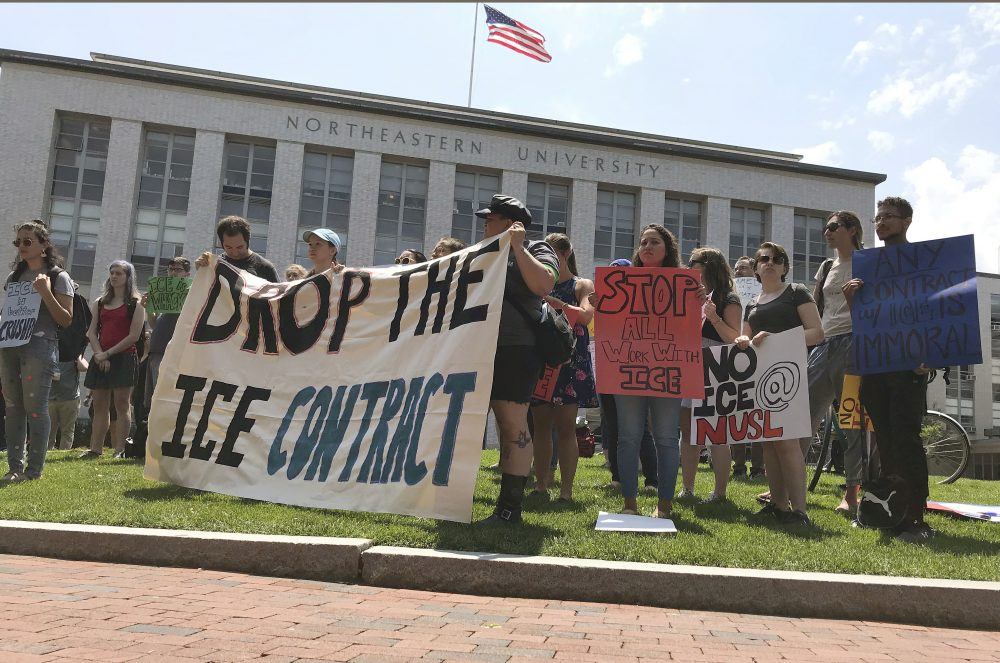 Students and community activists rally at Northeastern University, Wednesday, July 11, 2018, in Boston demanding the school cancel a multimillion-dollar research contract with U.S. Immigration and Customs Enforcement. Federal spending data show that Northeastern has received $2.7 million from ICE over the last two years. Northeastern said the grant isn't funding research that has anything to do with immigration enforcement. (Sarah Betancourt/AP)