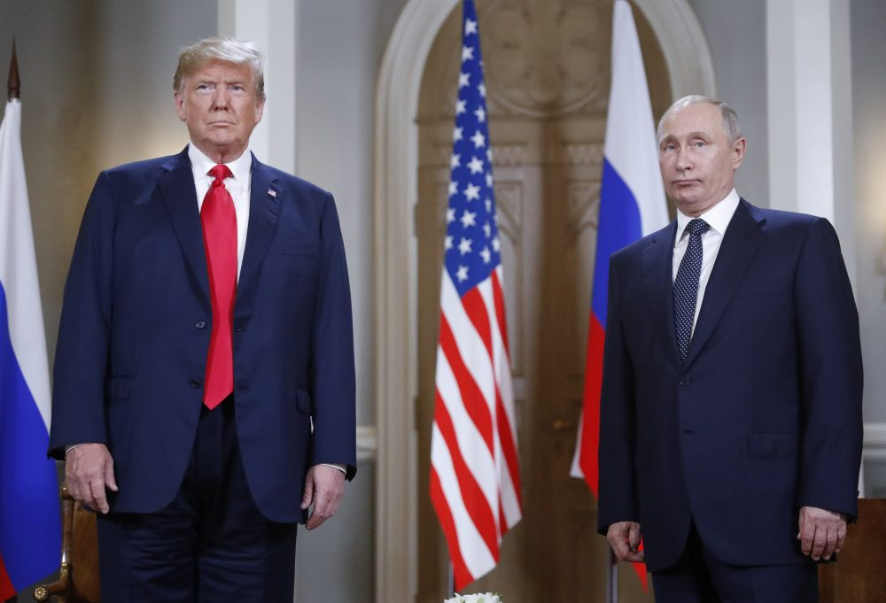 U.S. President Donald Trump, left, and Russian President Vladimir Putin pose for a photograph at the beginning of a one-on-one meeting at the Presidential Palace in Helsinki, Finland, Monday, July 16, 2018. (Pablo Martinez Monsivais/AP)