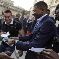 France forward Kylian Mbappe, center, and forward Ousmane Dembele sign autographs during an official reception at the Elysee Presidential Palace in Paris, Monday, July 16, 2018. (Ludovic Marin/AP)