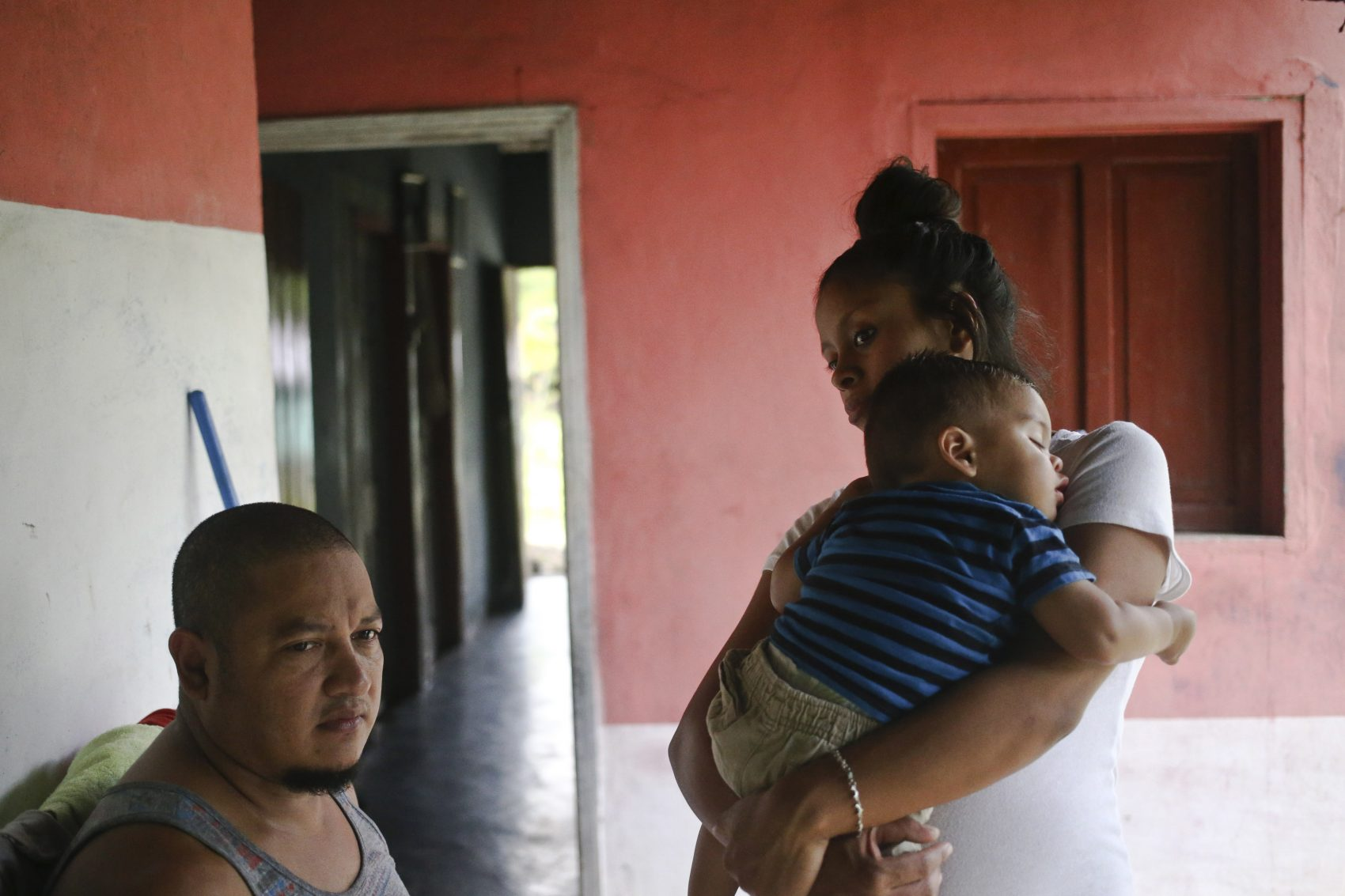 Adalicia Montecinos cradles her year-old son Johan, who became a poster child for the U.S. policy of separating immigrants and their children, during the first full day back with his family, in La Libertad, Honduras, Saturday, July, 21, 2018. Johan arrived in San Pedro Sula and was reunited with his parents on a government bus. Captured by Border Patrol agents in March, Johan's father was deported and the then 10-month-old remained at an Arizona shelter. Pictured at left is Johan's father Rolando Bueso Castillo. (Esteban Felix/AP)