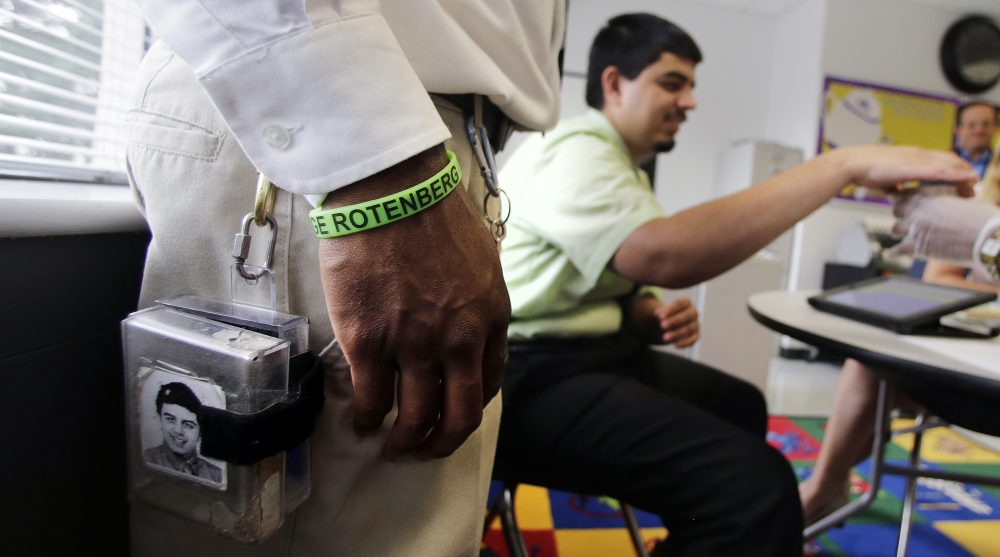 A therapist wears the remote shocking device on his belt as he monitors student Joshua Wood, who is autistic, at the Judge Rotenberg Educational Center in Canton, Massachusetts. Many students at the school, who were born with autism and development disorders, wear shocking devices to control violent outbreaks. (Charles Krupa/AP)
