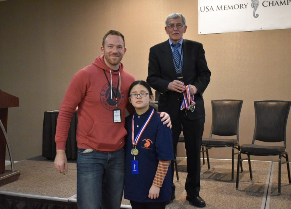 Repeat memory champ Nelson Dellis, new record-breaker Xuanxi Yang of Hershey Middle School, and USA Memory Championship founder Tony Dottino (Courtesy of USA Memory Championship)