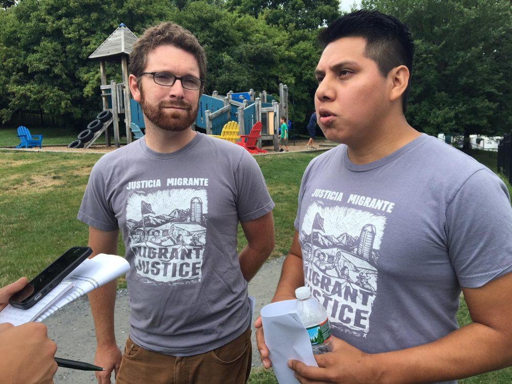 Will Lambek, left, interprets for Enrique Balcazar, a Migrant Justice activist who helped negotiate the fair labor and living standards agreement with Ben & Jerry's. (John Dillon/VPR)