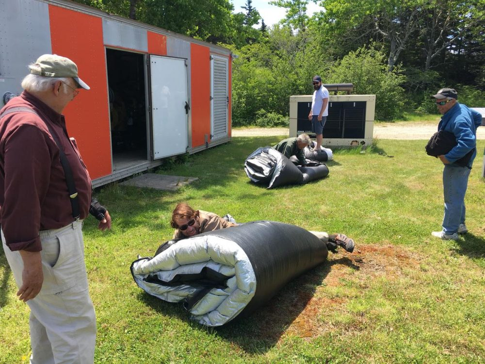 Storing tarps that protect the island's diesel generator. (Fred Bever/Maine Public Radio)