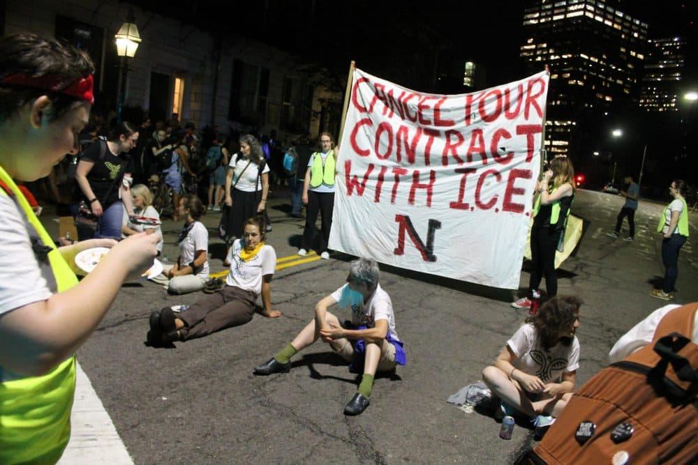 Anti-ICE protesters blocked Beacon Street in front of Northeastern President Joseph Aoun's house Tuesday night. (Sam Doran/SHNS)