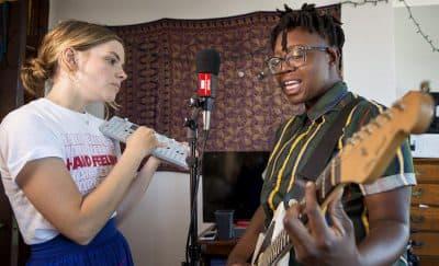 Photocomfort and Anjimile perform in Anjimile's apartment. (Robin Lubbock/WBUR)