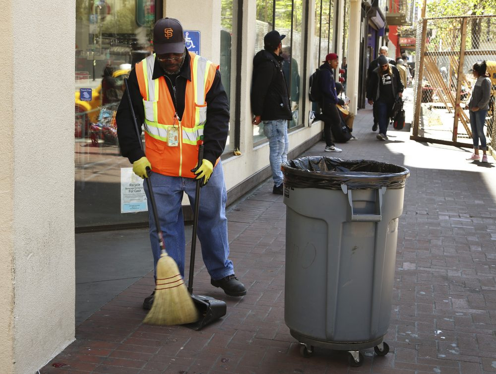 In this photo taken on Thursday, April 26, 2018, a city sanitation worker sweeps Market Street in San Francisco. San Francisco may have hit peak saturation with the stinky urine, used syringes and trash littering its filthy streets, and city leaders are paying attention. (Ben Margot/AP)