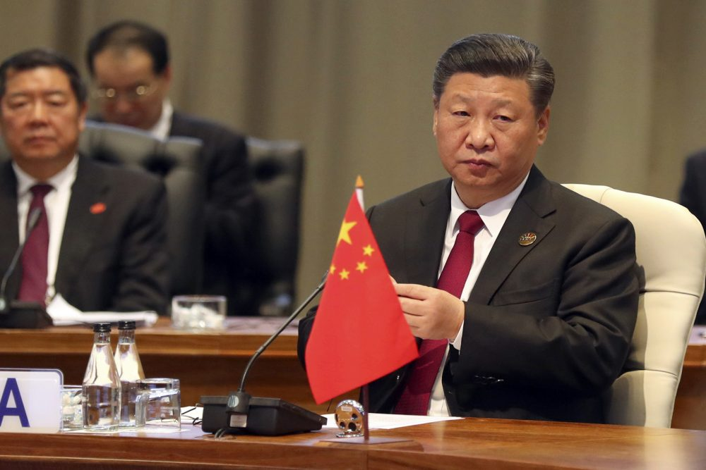 China's President Xi Jinping takes his seat for the first closed session of the BRICS summit, in Johannesburg, South Africa, Thursday, July 26, 2018. The five leaders of the BRICS emerging economies have gathered in South Africa for an annual summit where the United States is being criticized for escalating tariffs on foreign goods. (Mike Hutchings/Pool Photo via AP)