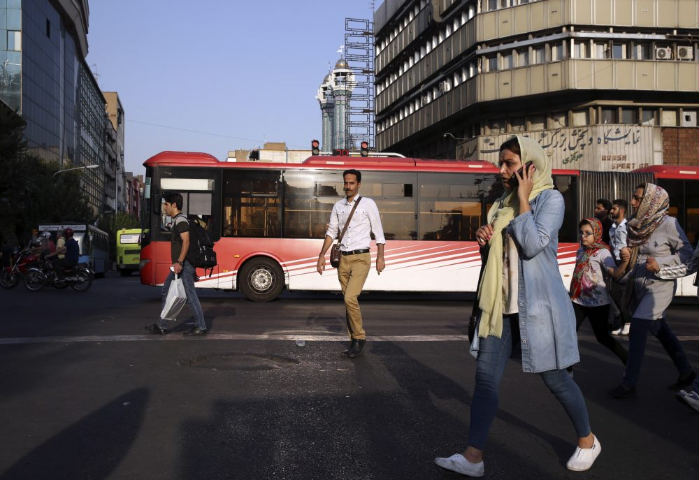 People cross Jomhouri-e-Eslami (Islamic Republic) St. in downtown Tehran, Iran, Monday, July 30, 2018. Iran's currency plummeted to a record low Monday, a week before the United States restores sanctions lifted under the unraveling nuclear deal, giving rise to fears of prolonged economic suffering and further civil unrest. (Vahid Salemi/AP)