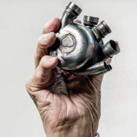 Dr. Bud Frazier's hand holding his lifelong dream, a self-contained artificial heart, the Bivacor, in 2016. (Texas Heart Institute)