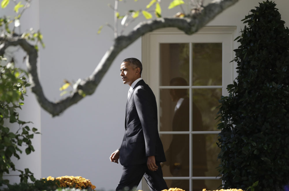 President Barack Obama walks from the Oval Office and across the South Lawn of the White House in Washington, Friday, Oct. 28, 2016, before boarding Marine One helicopter for the short flight to Andrews Air Force Base, Md., en route to Florida to speak at a Hillary for America campaign event. (Carolyn Kaster/AP)