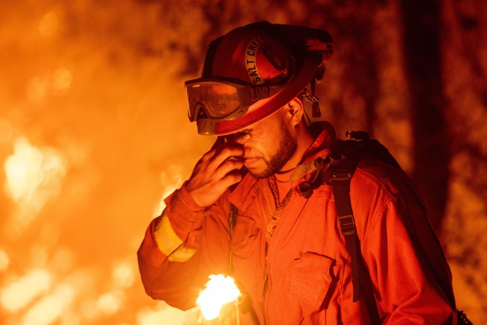 An inmate firefighter pauses during a firing operation as the Carr Fire burns in Redding, Calif., on July 27, 2018. (Josh Edelson/AFP/Getty Images)