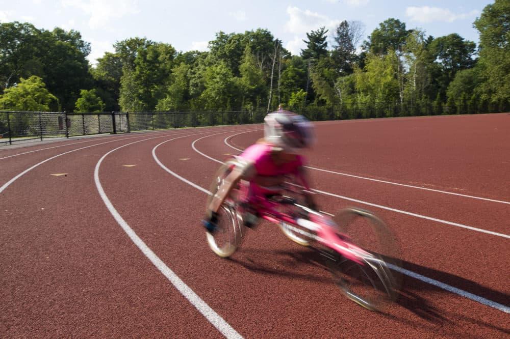 Maddie Wilson speeds around the track at Wellesley High School. (Jesse Costa/WBUR)