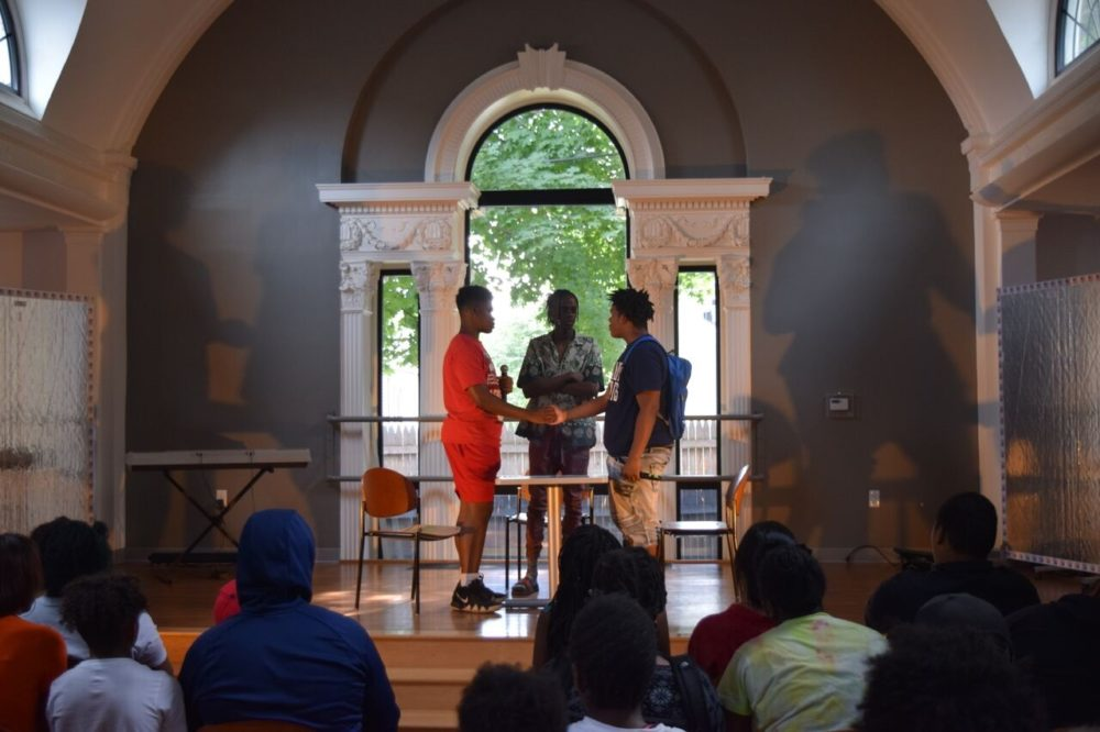 "Jaye Kincade, Clark LaCossade and D'Ahmen Holloman in a performance of ""The Conversation"" at the Mattapan Teen Center. (Courtesy Boston Lyric Opera)"