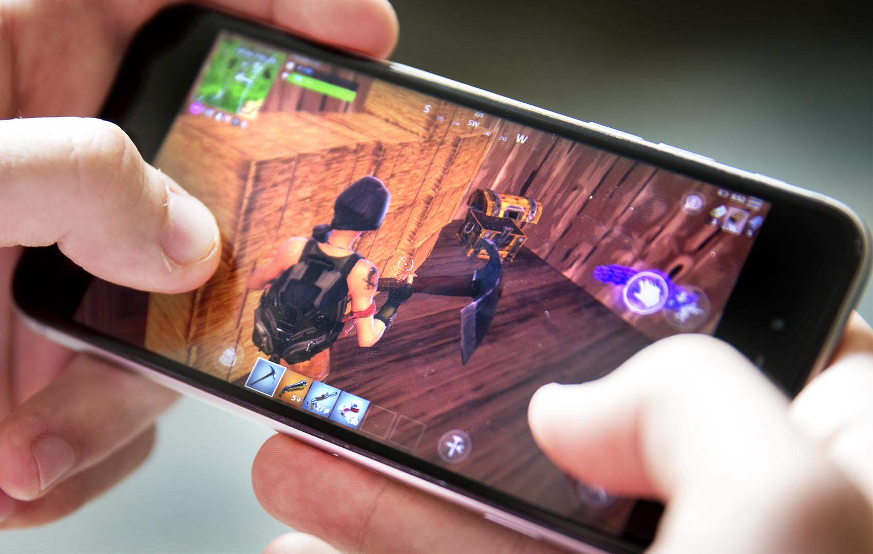 "A player finds a treasure chest in the online game ""Fortnite."" (Robin Lubbock/WBUR)"