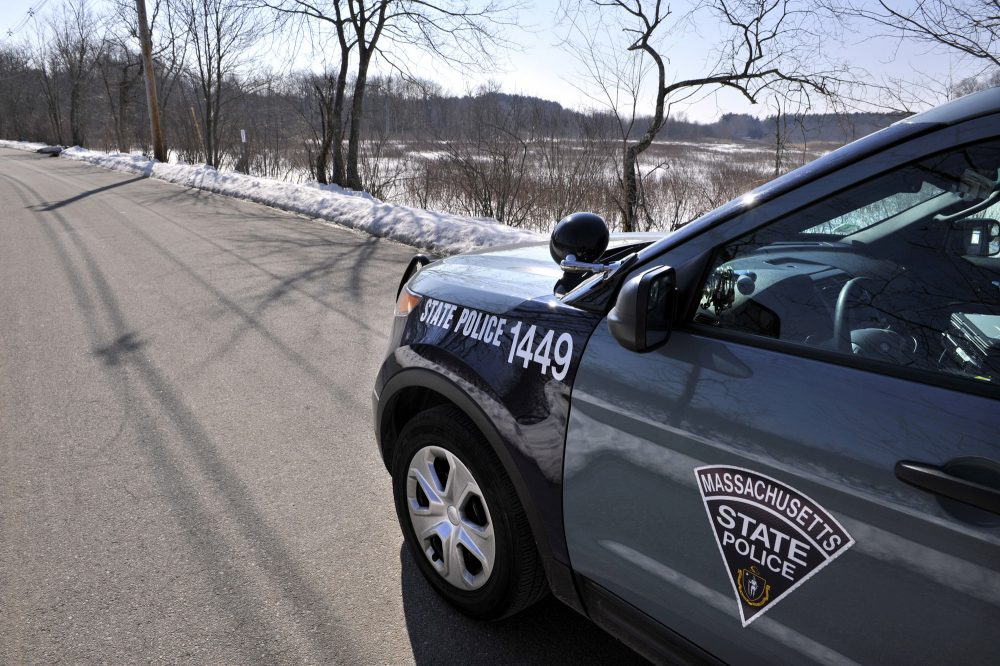 A state police vehicle sits on Water Row in in Wayland, Mass., Friday, Feb. 15, 2013.  (AP Photo/The Boston Globe, Josh Reynolds, Pool)