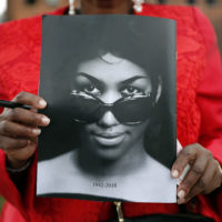 Sharon Napoleon holds a program as she stands outside a viewing for legendary singer Aretha Franklin at New Bethel Baptist Church Thursday, Aug. 30, 2018, in Detroit. Franklin died Aug. 16, 2018 of pancreatic cancer at the age of 76. (Jeff Roberson/AP)