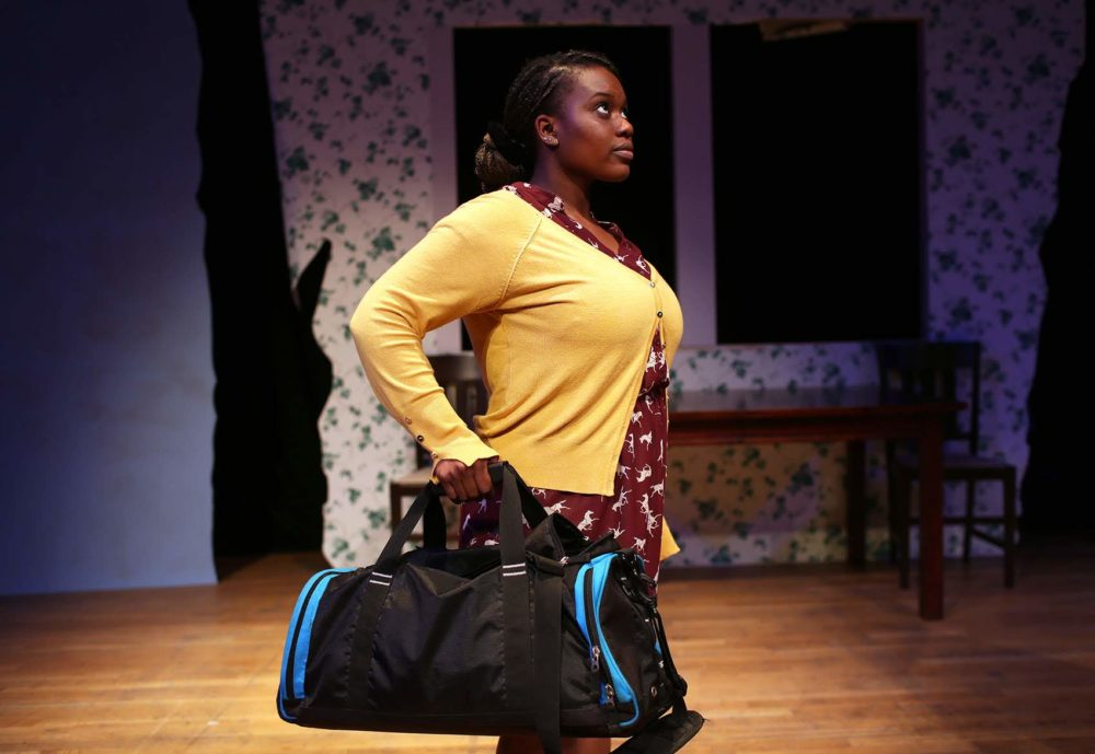 "Tenneh Sillah of Roslindale goes through a scene during rehearsal for ""This Placed / Displaced"" at the Charlestown Working Theater. (Hadley Green for WBUR)"