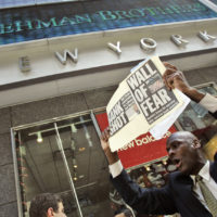 A man demonstrates outside the Lehman Brothers headquarters Monday, Sept. 15, 2008 in New York. When Wall Street woke up Monday morning, two more of its storied firms had fallen. Lehman Brothers, burdened by $60 billion in soured real-estate holdings, filed a Chapter 11 bankruptcy petition in U.S. Bankruptcy Court after attempts to rescue the 158-year-old firm failed. (Mary Altaffer/AP)