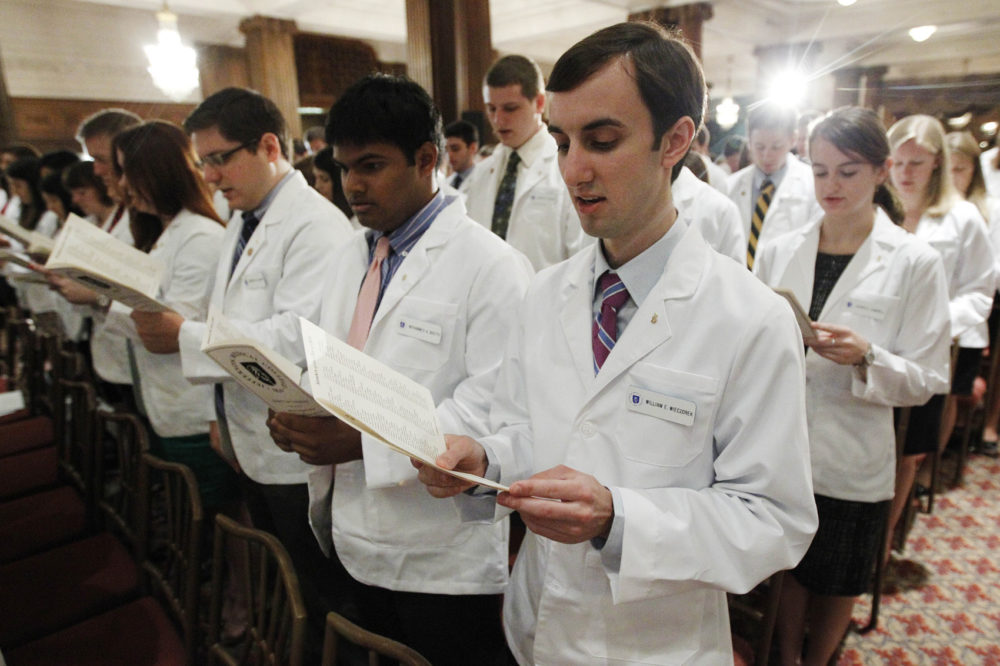 Thomas Jefferson University's Jefferson Medical College first-year student William E. Wieczorek and others take the Hippocratic Oath during the annual White Coat Ceremony, Friday, Aug. 5, 2011, in Philadelphia. The ceremony symbolizes the clinical beginning of the students' medical educations. (Matt Rourke/AP)