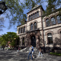 Passers-by walk past Sayles Hall on the campus of Brown University.  (Steven Senne/AP)