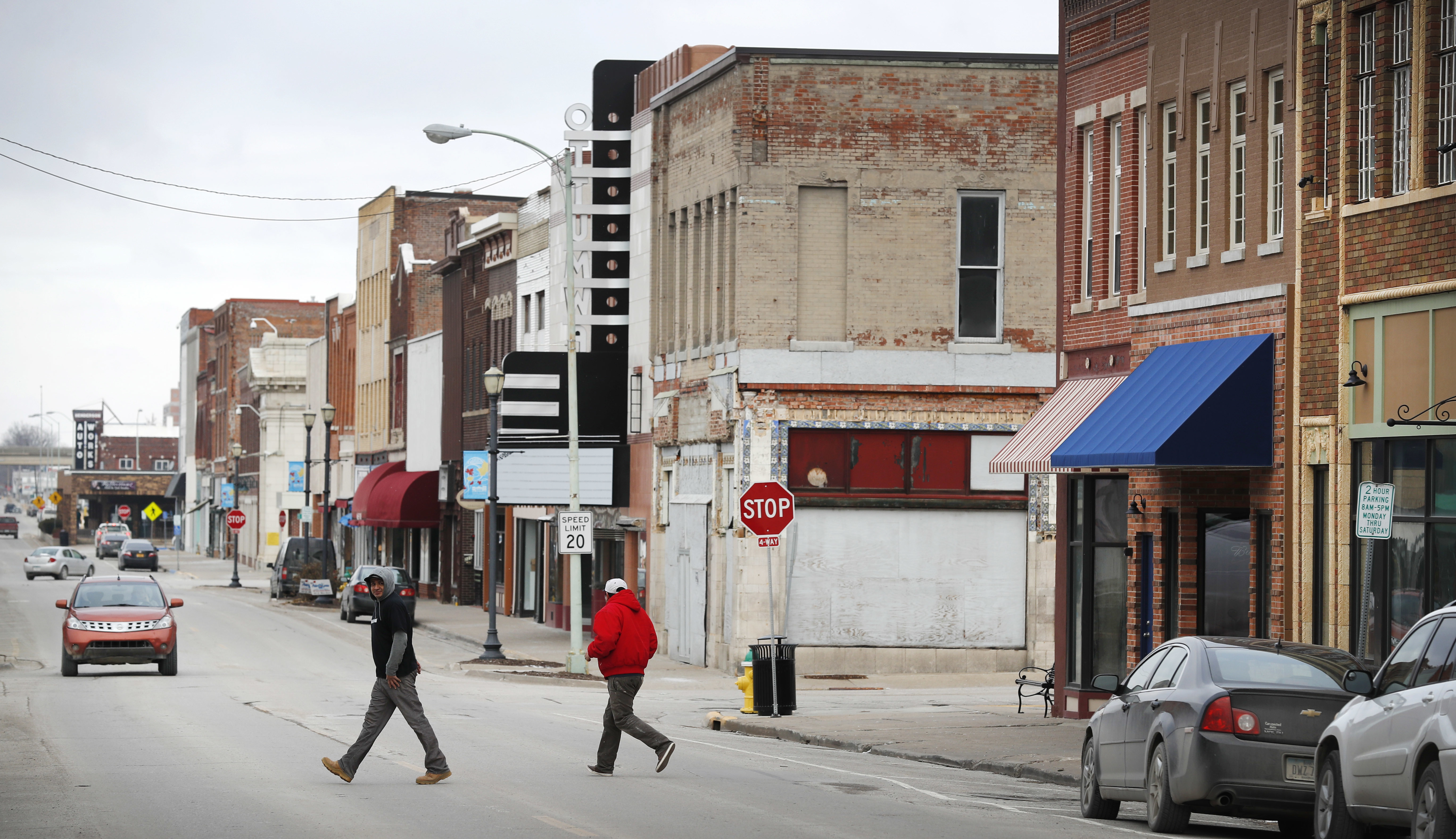 Local residents walk across Main Street, Friday, Jan. 27, 2017, in Ottumwa, Iowa. Far from the cacophony enveloping Washington in President Donald Trump's first week in office, the Iowa voters who helped him capture the state and the presidency last November give the president high marks for reversing eight years of Democrat Barack Obama's policies. (Charlie Neibergall/AP)