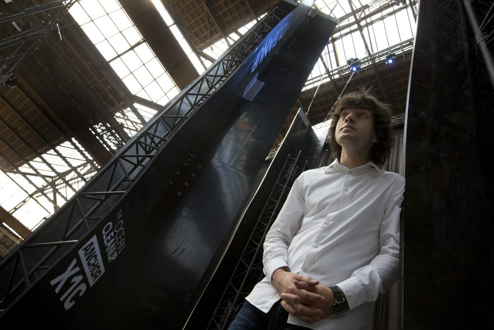 Dutch entrepreneur Boyan Slat, who founded The Ocean Cleanup project, poses for a portrait next to the anchors of his plastic collecting system, suspended from the roof of a building in Utrecht, Netherlands, in 2017. (Peter Dejong/AP)