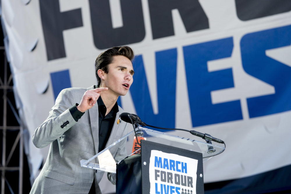 "David Hogg, a survivor of the mass shooting at Marjory Stoneman Douglas High School in Parkland, Fla., speaks during the ""March for Our Lives"" rally in support of gun control in Washington, on March 24, 2018. (Andrew Harnik/AP)"