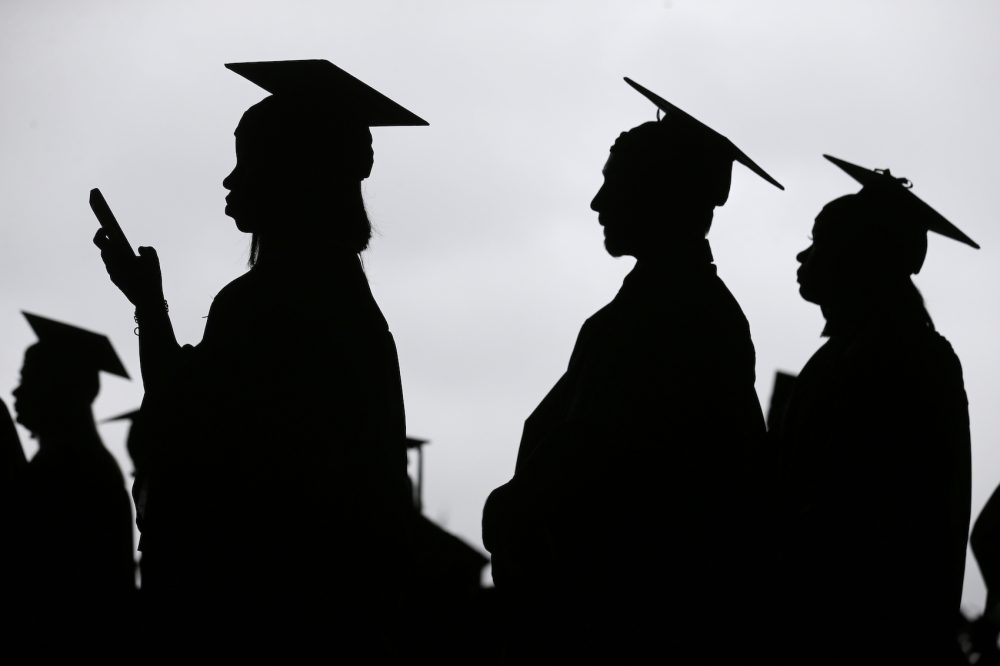 In this May 17, 2018, file photo, new graduates line up before the start of the Bergen Community College commencement at MetLife Stadium in East Rutherford, N.J. Obtaining a college degree has increasingly coincided with ever-higher student debt loads. Since 2004, total student debt has climbed more than 540 percent to $1.4 trillion, according to the New York Federal Reserve. (Seth Wenig, File/AP)