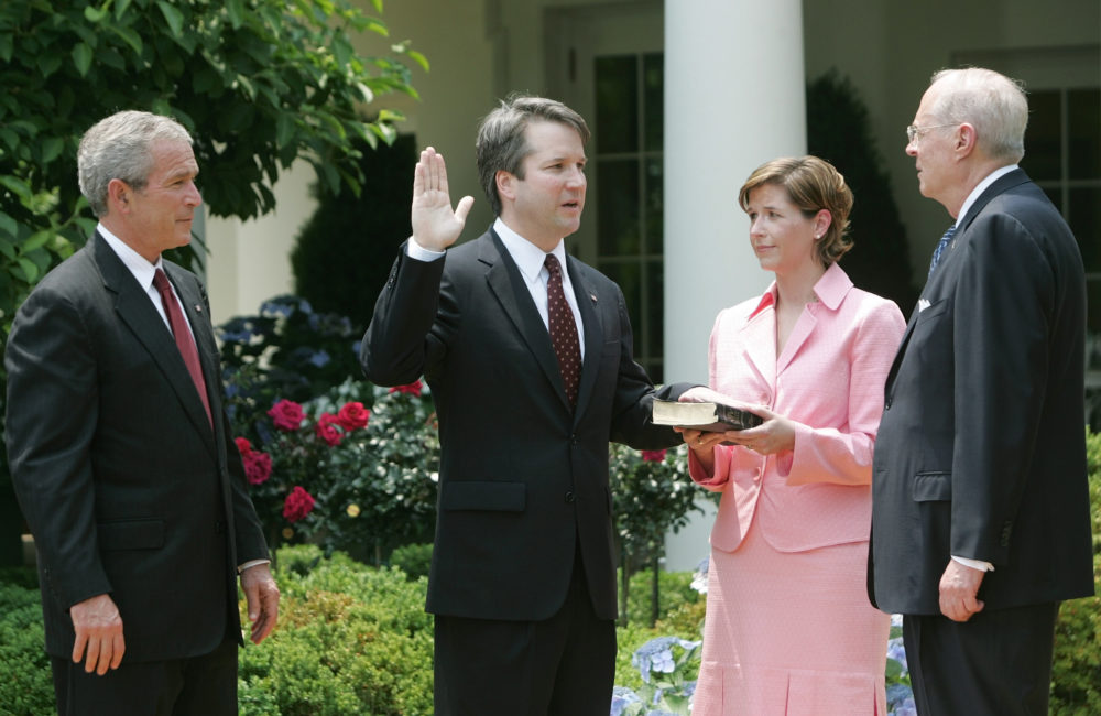 In this June 1, 2006 file photo, from left to right, President Bush, watches the swearing-in of Brett Kavanaugh as Judge for the U.S. Court of Appeals for the District of Columbia by U.S. Supreme Court Associate Justice Anthony M. Kennedy, far right, during a ceremony in the Rose Garden of the White House, in Washington. (Pablo Martinez Monsivais/AP)