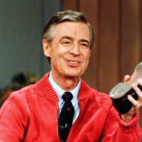 """This June 28, 1989, file photo, shows Fred Rogers as he rehearses the opening of his PBS show """"Mister Rogers' Neighborhood"""" during a taping in Pittsburgh. A new Fred Rogers Trail promoted by VisitPA.com includes museums, memorials and other sites. This year, 2018, marks the 50th anniversary of """"Mister Rogers' Neighborhood"""" and a new documentary called """"Won't You Be My Neighbor?"""" has helped rekindle interest in his legacy. (Gene J. Puskar/AP)"""