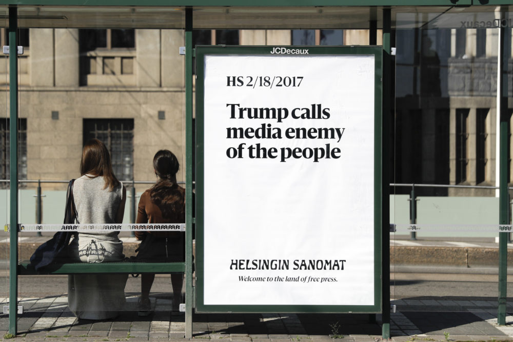 A poster is displayed by Finnish newspaper Helsingin Sanomat at a stop for public transport in Helsinki, Sunday, July 15, 2018. (Markus Schreiber/AP)