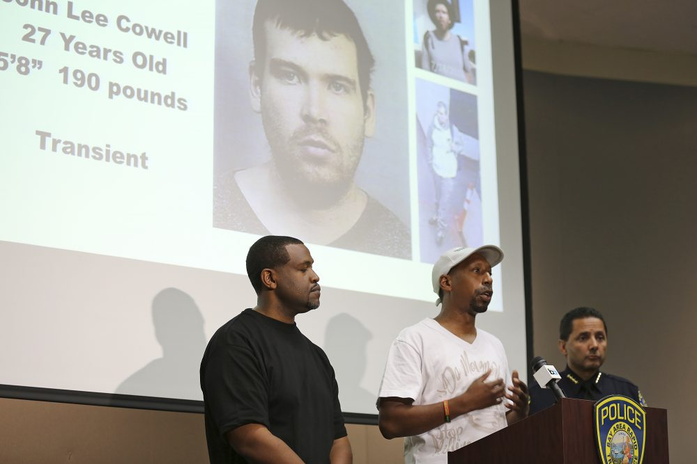 Daryle Allums, center, speaks on behalf of the Stop Killing Our Kids movement, about the stabbing of his goddaughter at a press conference Monday, July 23, 2018 in Oakland, Calif., as Bay Area Rapid Transit Police Chief Carlos Rojas, right, and Daryle Muhammad, left, listen. The suspect in the stabbing, John Lee Cowell, 27, is seen projected in the background. A man fatally stabbed an 18-year-old woman in the neck and wounded her sister as they exited a train at a Northern California subway station in what officials said Monday appeared to be a random attack. The suspect attacked the sisters Sunday night as they left a train at the Bay Area Rapid Transit's MacArthur Station in Oakland. (Lorin Eleni Gill/AP)