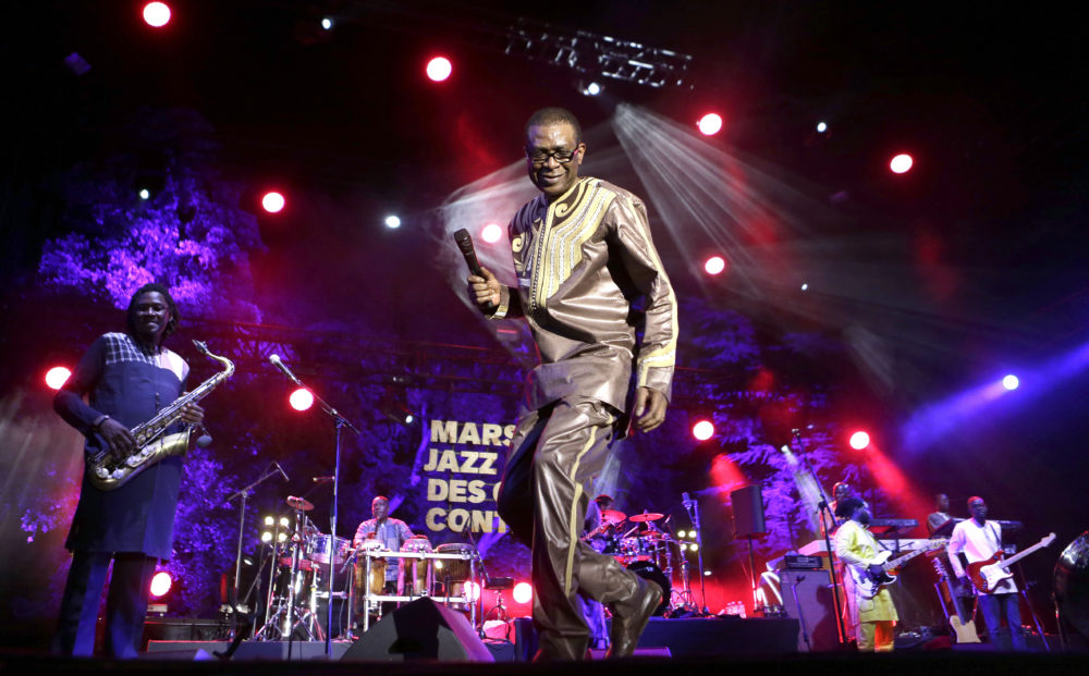 Senegalese singer Youssou N'Dour performs with the Super Star of Dakar group at the Five Continents Marseille Jazz festival, in Marseille, southern France, Wednesday, July 25, 2018. (Claude Paris/AP)