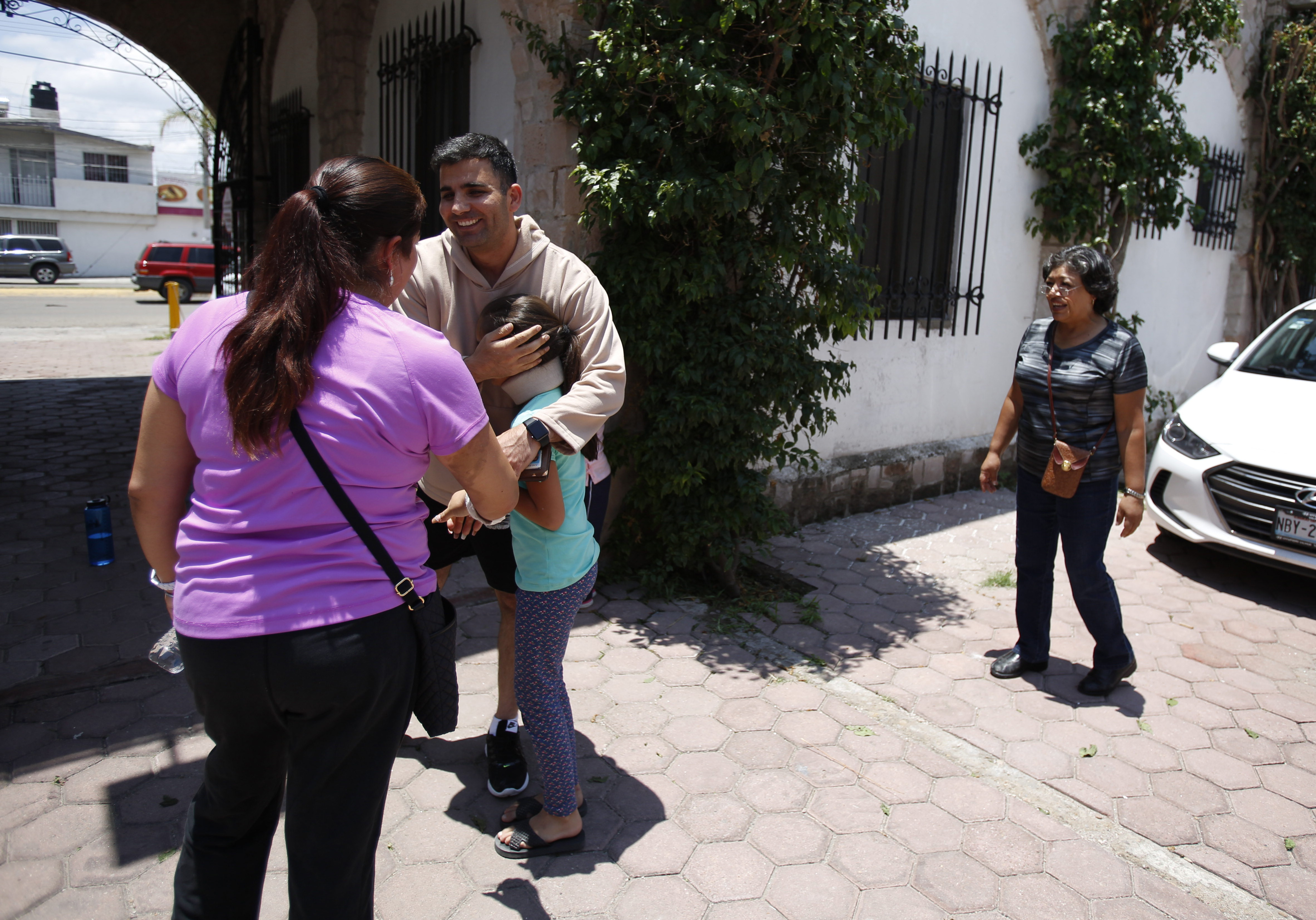 Ramin Parsa of Los Angeles hugs a woman and her two children who were fellow passengers aboard Aeromexico flight 2431, as they meet again at an office where U.S. citizens who lost their passports in the crash were receiving help from a consular official, in Durango, Mexico Wednesday, Aug. 1, 2018. (Rebecca Blackwell/AP)