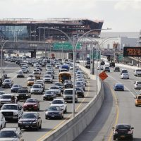 In this Aug. 1, 2018, photo, cars on the Grand Central Parkway pass LaGuardia Airport in New York. The Trump administration has proposed rolling back tougher Obama-era gas mileage requirements that are set to take effect after 2020. (Frank Franklin II/AP)